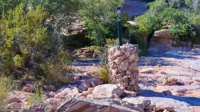 Trail marker, encased in stone